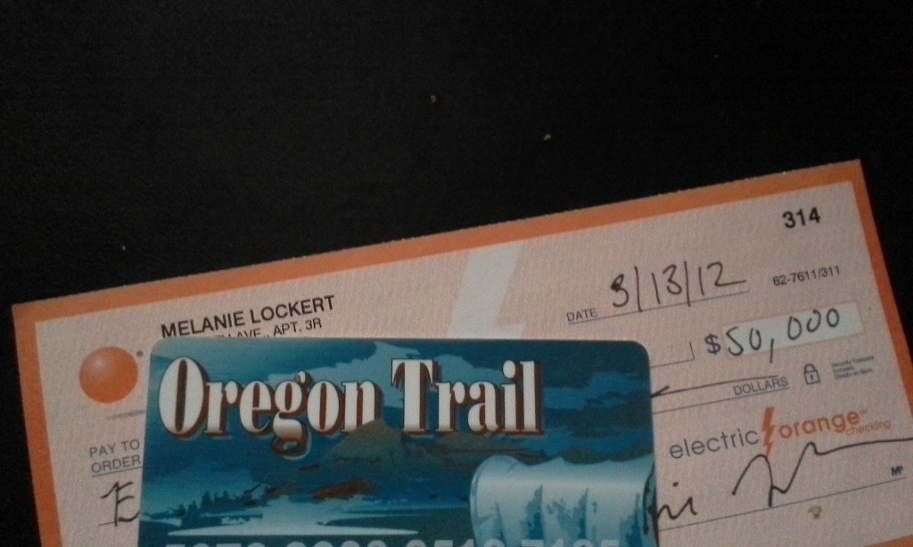The check in question + my old food stamp card. Oregon's food stamp card is literally called the Oregon Trail card.